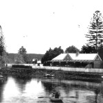 Reyburn House circa 1900; Now with the addition of the east wing. In the foreground is Stanely Reyburn, son of Robert Reyburn Jnr, rowing for home.